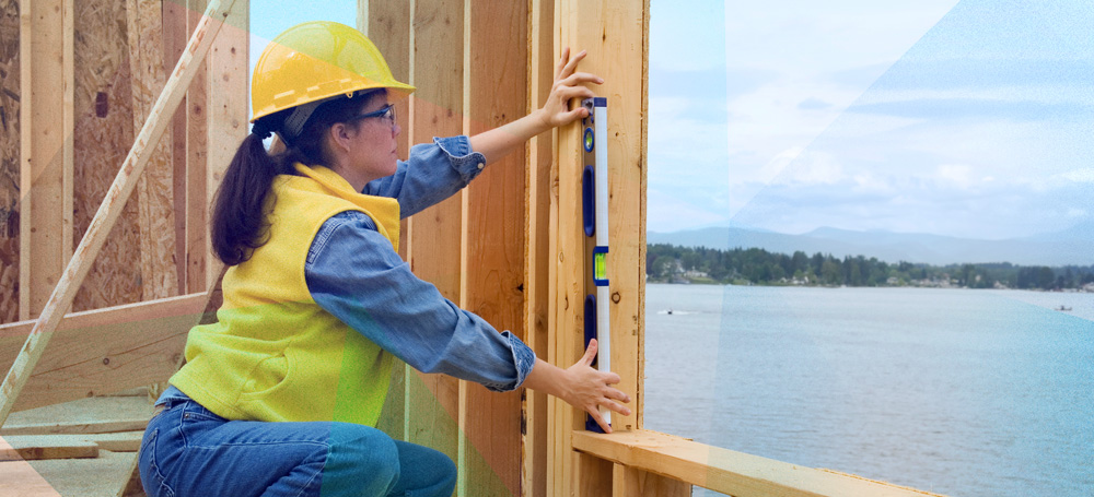 Woman measuring on construction site